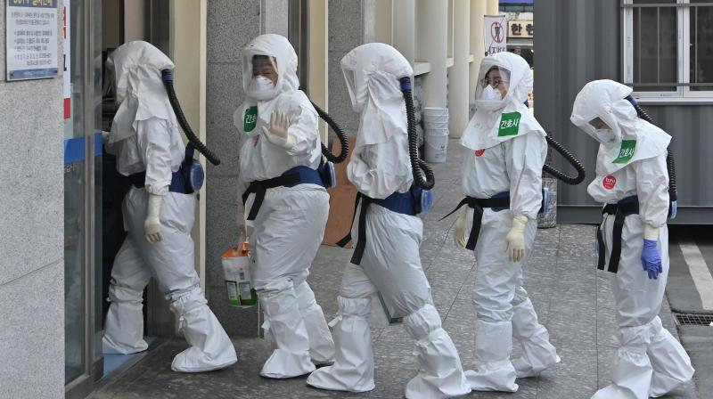 South Korean nurses wearing protective gear arrive for their shift to care for patients infected with the COVID-19 coronavirus at Keimyung University Daegu Dongsan Hospital in Daegu. (AFP)