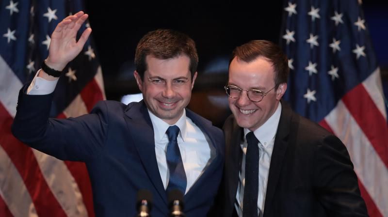With his husband Chasten by his side, former South Bend, Indiana Mayor Pete Buttigieg announces he is ending campaign to be the Democratic nominee for president during a speech at the Century Center. AFP Photo