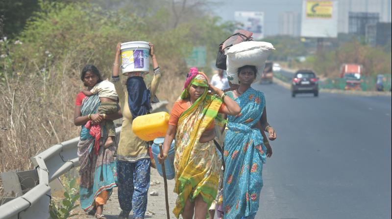 Migrant workers from Akola district of Maharashtra walk along Mumbai-Nashik highway to reach their native places, during a nationwide lockdown in the wake of coronavirus, in Thane. PTI Photo
