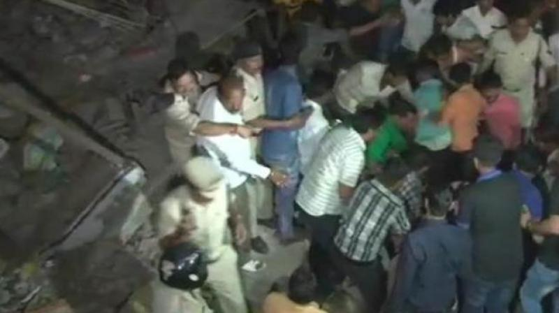 A four-story building collapsed near Sarvate Bus Stand at around 10 pm on Saturday. Rescue operations are underway (Photo: Twitter/ANI)