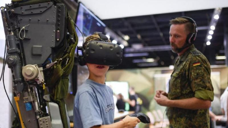 However, the military personnel was careful to spell out the difference between the reality of life in the ranks and violent military-based video games. (Photo: AFP)