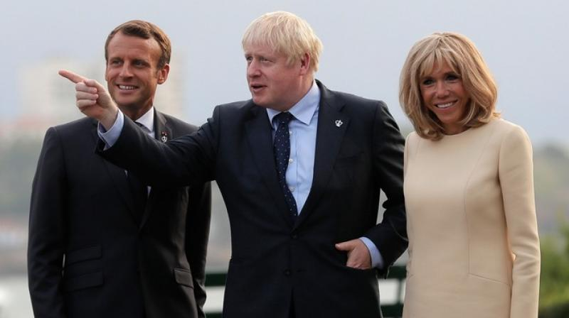 British Prime Minister Boris Johnson and EU Council President Donald Tusk exchanged accusations at the G7 summit Saturday over who will be to blame if Britain crashes out the bloc without an accord. (Photo: AP)