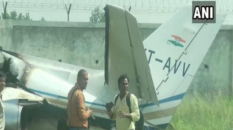 A trainer aircraft, VT-AVV, crashed here at the Dhanipur airstrip after one of its wheels got stuck in wires during the landing on Tuesday. (Photo: ANI)