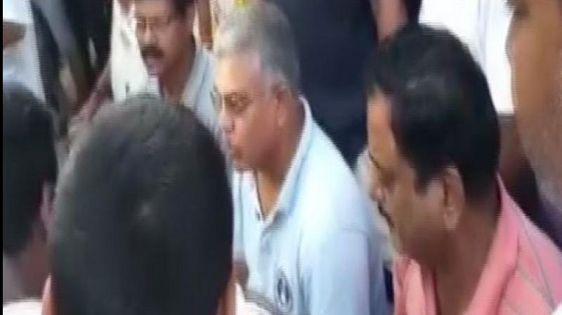 A ruckus broke out during the 'Chai Pe Charcha' event here on Friday in the presence of West Bengal BJP president Dilip Ghosh after TMC workers staged a protest at the venue. (Photo: ANI)