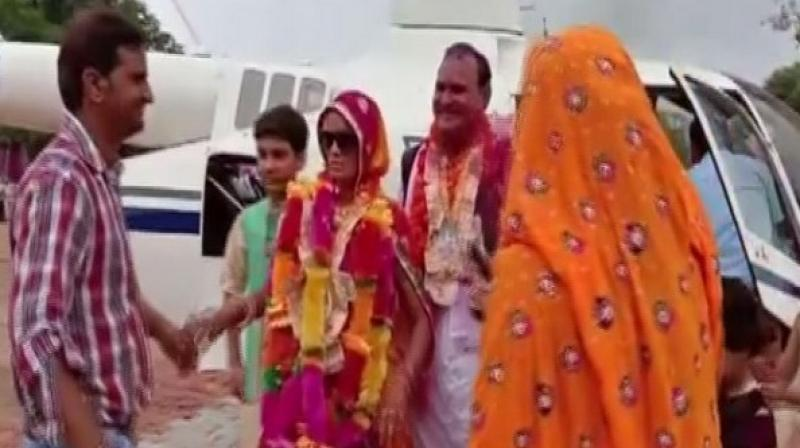 After his wife once asked him how much it would cost to hire a chopper, a school teacher in Rajasthan's Alwar decided to fulfil her wish on his retirement. (Photo: ANI)
