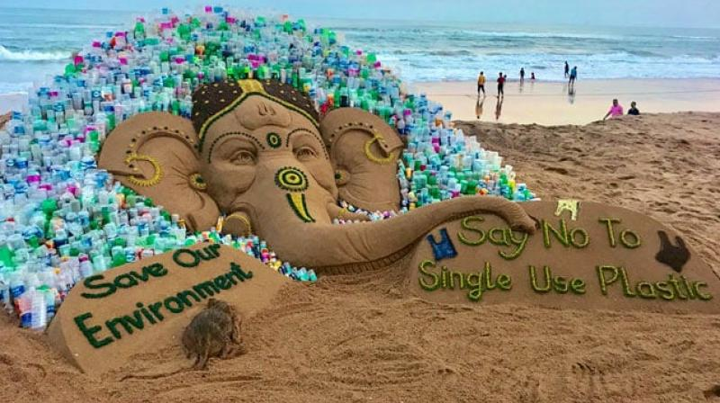 The 10-ft high sand sculpture of Lord Ganesh was created by using 5 tonne of sand, while about 1000 plastic bottles were installed around it, he said. (Photo: Twitter/ sudarsansand)