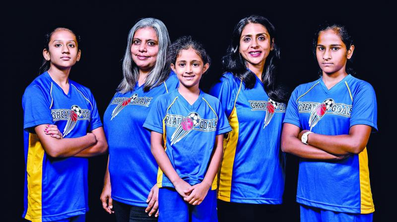 Priya Gopalen and Sandhya Rajan with their team