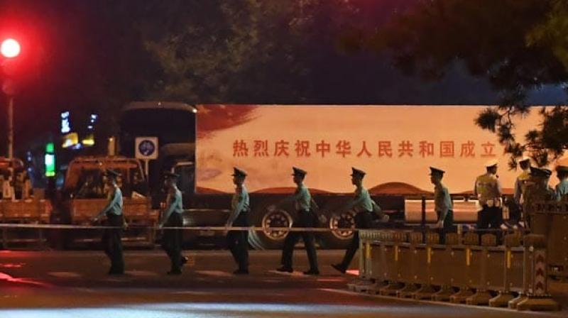 The centre of Beijing was under lockdown early Sunday for a night-time parade rehearsal by the Chinese military which is preparing for October 1 ceremonies to mark Communist China's 70th anniversary. (Photo: AFP)