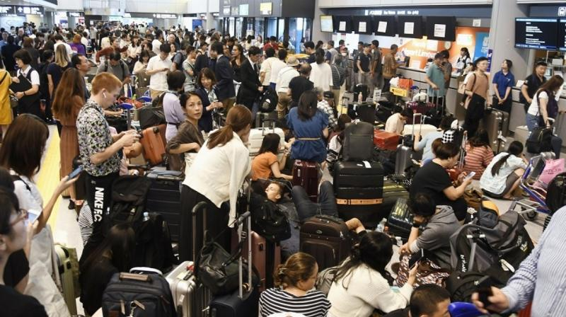 Around 17,000 passengers were stranded overnight at Tokyo's Narita Airport, an official said Tuesday, after it took a direct hit from a powerful typhoon that caused transport chaos throughout the capital. (Photo: AP)