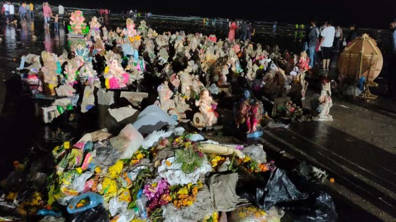 The idols and trash collected on Friday night at Juhu beach.