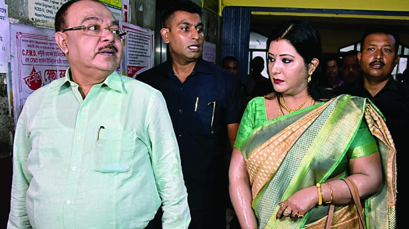 BJP leader and former mayor of Kolkata Sovan Chatterjee with BJP leader Baisakhi Banerjee arrive at CBI office in Kolkata on Wednesday. (Photo: ANI)