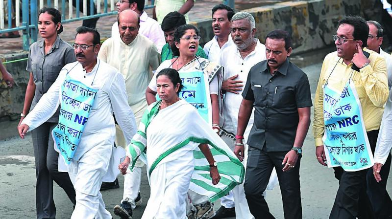 West Bengal Chief Minister Mamata Banerjee leads a rally in Kolkata on Thursday to protest against the NRC in Assam. Ms Banerjee warned the BJP not to play with fire in the name of NRC and said she would never allow the exercise in the state. (Photo: PTI)