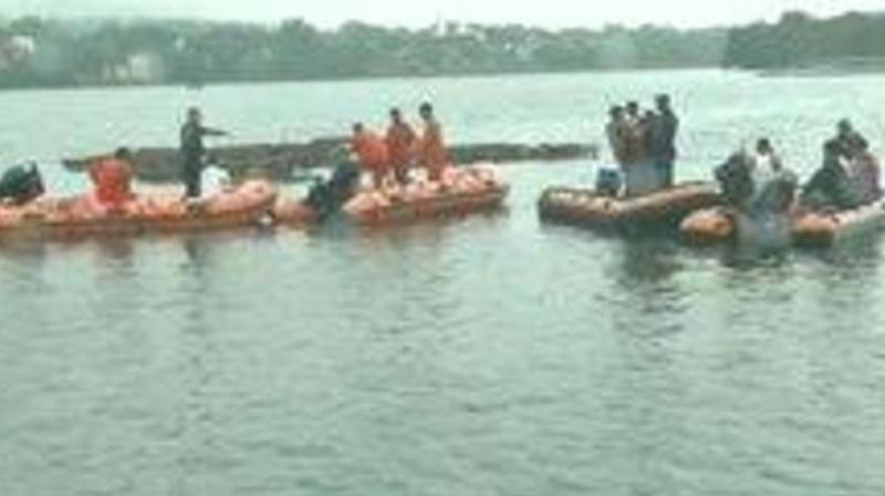At least 11 bodies were recovered while five people have been rescued at Khatlapura Ghat in Bhopal after the boat they were in capsized Friday morning during Ganesh immersion. (Photo: ANI)