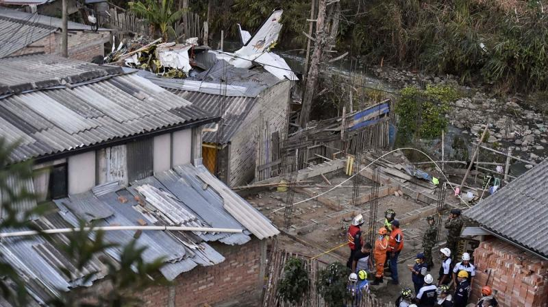 At least seven people were killed and another three injured when a small plane crashed in southwestern Colombia on Sunday, a firefighter said. (Photo: AFP)