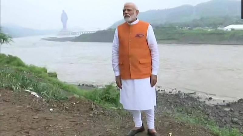 Prime Minister Narendra Modi, who turned 69, reached the Sardar Sarovar Dam around 8:45 am on Wednesday to celebrate his birthday in home state Gujarat. (Photo: Twitter/ ANI)