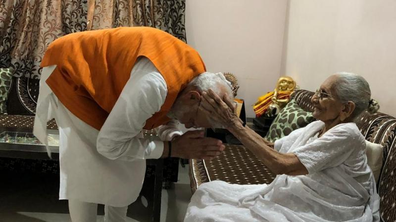 Prime Minister Narendra Modi visited his mother Heeraben Modi's residence here to take blessings on his 69th birthday on Tuesday. (Photo: Twitter/ ANI)