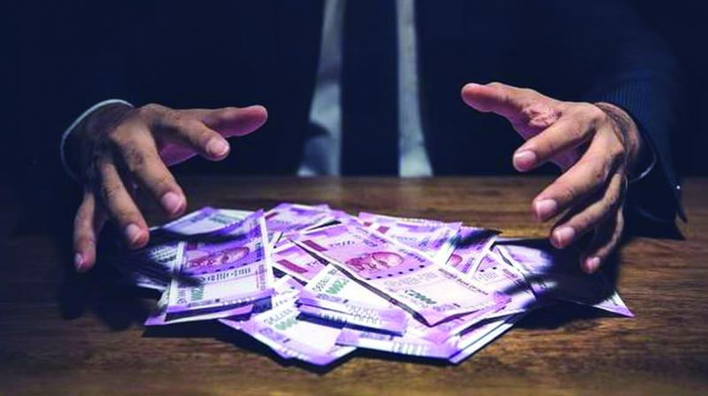 Income tax officials are unhappy with the mopup so far in this fiscal. They feel that the economic slowdown and the IT Department's strategy of going slow on the corporates, in the aftermath of the suicide of Cafe Coffee Day founder VG Siddhartha in July, have impacted the over all tax collections between April 1 and September 17.