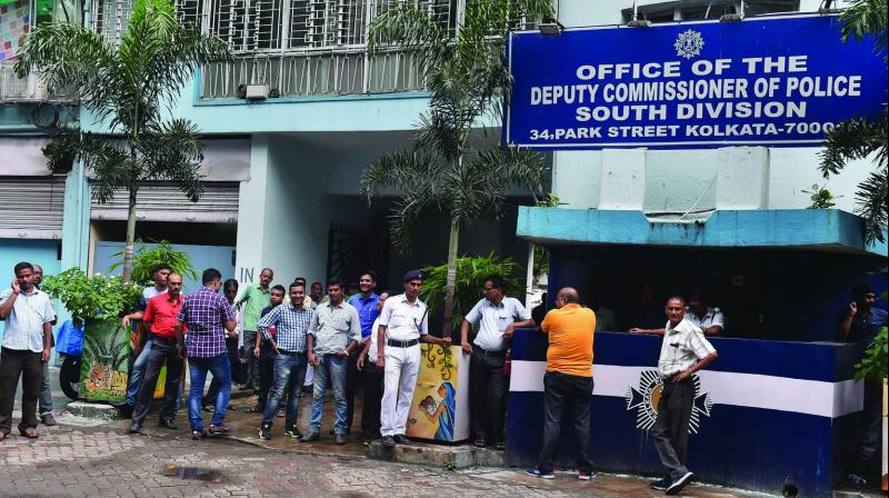 Police personnel in plain clothes seen outside the official residence of former Kolkata police commissioner Rajeev Kumar in Kolkata on Wednesday. (Photo: PTI)