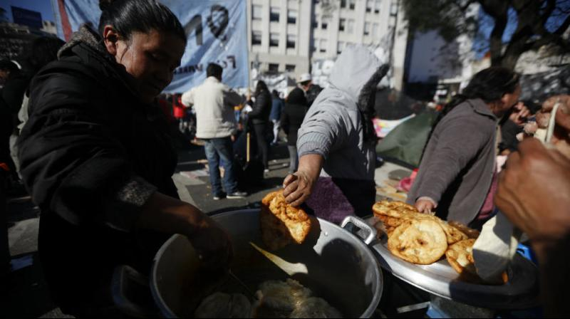 Argentina's Senate unanimously approved a law on Wednesday that will increase state funds dedicated to fighting hunger and improving nutrition as the country grapples with stifling inflation and increased poverty. (Photo: AFP)