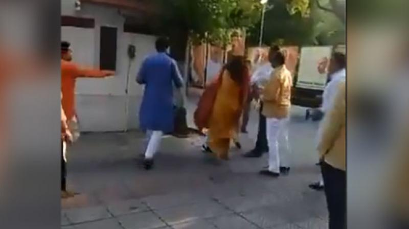Bharatiya Janata Party's Mehrauli district chief Azad Singh was seen slapping his wife, an ex-South Delhi mayor, at the party's Delhi office right after a poll-preparedness meeting with senior leader Prakash Javadekar on Thursday. (Photo: ANI)