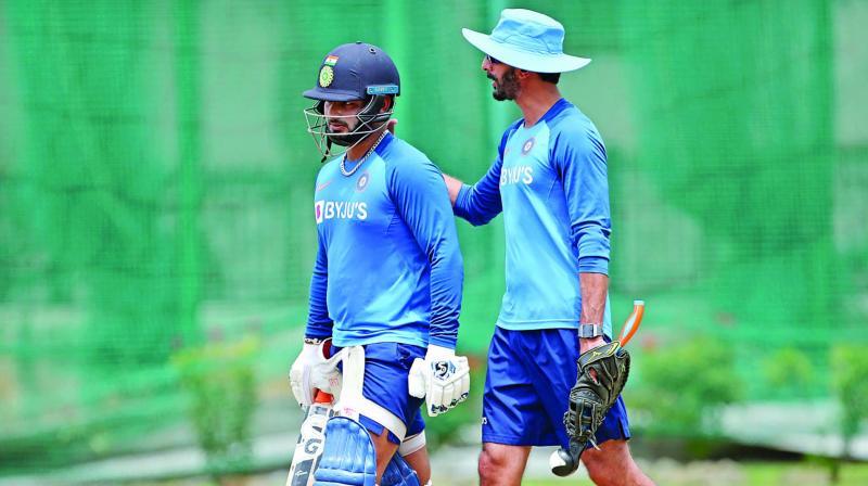 Rishabh Pant and batting coach Vikram Rathour.