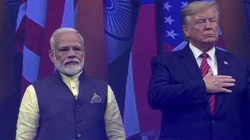 US President Donald Trump and Prime Minister Narendra Modi on stage at NRG stadium in Houston. (Photo: ANI)