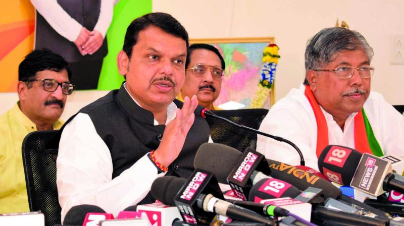 File image of former Chief minister Devendra Fadnavis with Chandrakant Patil.