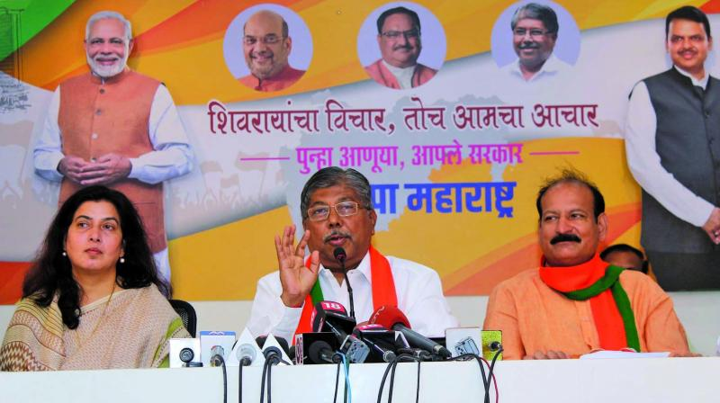 Chandrakant Patil addressing a press conference at the BJP headquarters in South Mumbai. (Photo: ASIAN AGE)