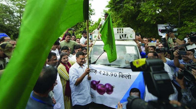 Chief minister Arvind Kejriwal flags off mobile vans which will sell onions in all the Assembly constituencies at the Delhi Secretariat on Saturday. (Photo: PTI)