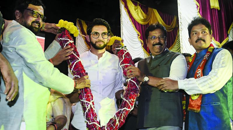 Yuva Sena chief Aaditya Thackeray, the elder son of party chief Uddhav Thackeray, being garlanded during a rally to announce his candidature from Worli seat. (Photo: PTI)