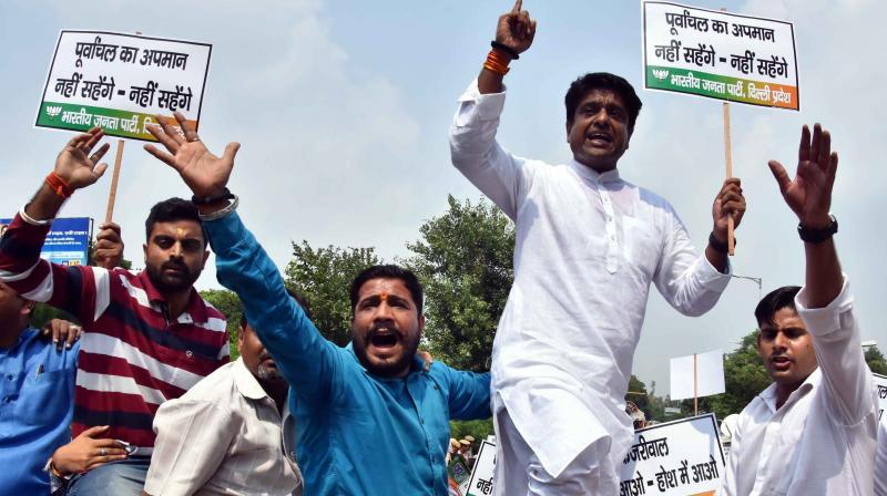 BJP workers during a protest on the Purvanchal issue in New Delhi on Tuesday. (Photo: ASIAN AGE)
