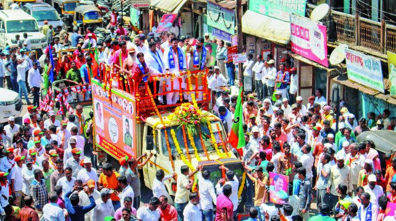 BJP candidates for Satara Lok Sabha and Assembly seats Udayanraje Bhosale and Shivendraraje Bhosale during their nomination filing procession in Satara, Tuesday. (Photo: PTI)