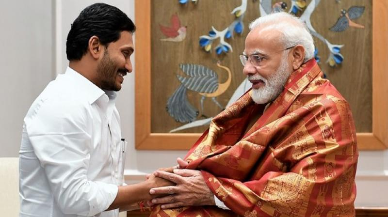 Andhra Pradesh Chief Minister YS Jagan Mohan Reddy met Prime Minister Narendra Modi here on Saturday and invited him for the inauguration of prestigious 'YSR Raithu Bharosa' scheme in the state. (Photo: ANI)