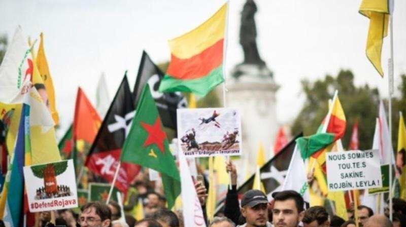 """Thousands of people, some shouting """"Erdogan terrorist"""", took to the streets of Paris and other European cities on Saturday in protest at the Turkish assault on Kurds in Syria. (Photo: AFP)"""