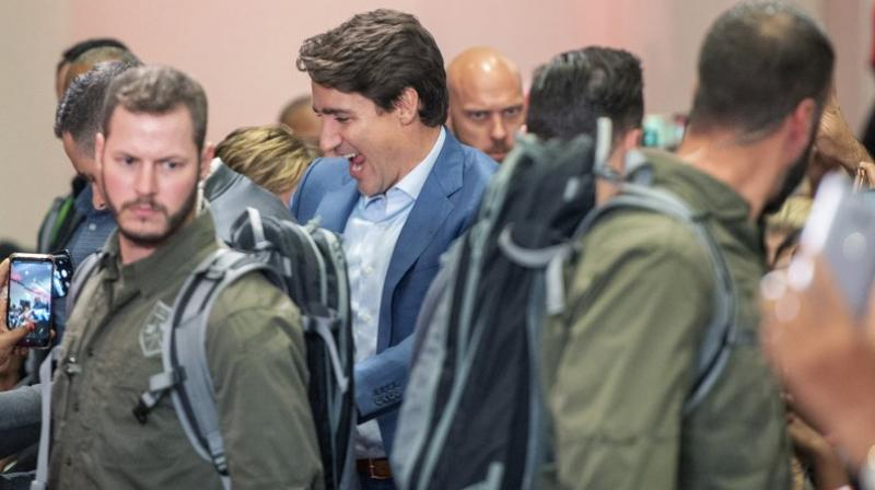 Canadian Prime Minister Justin Trudeau donned an armored vest and appeared with a heavy security detail at a major election rally on Saturday. (Photo: AP)