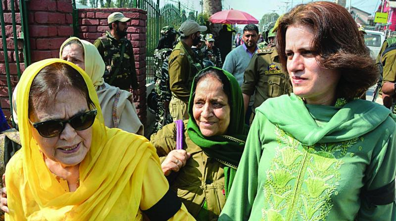 Farooq Abdullah's sister Suriya and daughter Safiyah during a protest against the abrogration of Article 370 in Srinagar on Tuesday. (Photo: PTI)