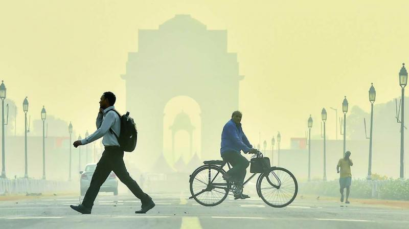A view of Rajpath road engulfed in haze in New Delhi on Thursday. (Photo: PTI)