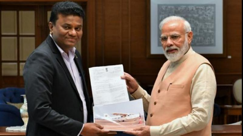 Maharashtra pilot Amol Yadav, who had got a Rs 35,000 crore deal for India's first plane factory last year, met Prime Minister Narendra Modi on Sunday. (Photo: Twitter/ ANI)