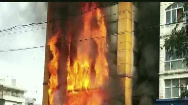 A massive fire broke out in a four-floor hotel in Madhya Pradesh's Indore city on Monday, police said. (Photo: ANI)