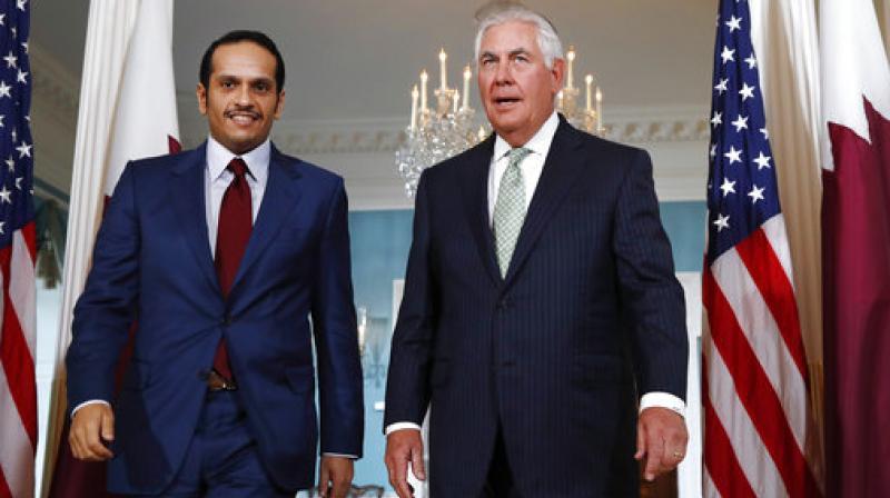 Secretary of State Rex Tillerson walks with Qatari Foreign Minister Sheikh Mohammed bin Abdulrahman Al Thani (Photo: AP)