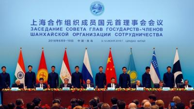 Leaders of member states of the Shanghai Cooperation Organization (SOC) from left Indian Prime Minister Narendra Modi, Tajikistan President Imomali Rakhmon, Russian President Vladimir Putin, Chinese President Xi Jinping, Kazakh President Nursultan Nazarbayev, Uzbekistan's President Shavkat Mirziyoyev and President of Pakistan Mamnoon Hussain sign an agreements for the SOC summit in Qingdao in eastern China's Shandong Province, Sunday, June 10, 2018. (Photo: AP)