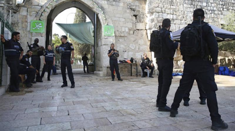 Israel has begun dismantling metal detectors it installed a week earlier at the gates of a contested Jerusalem shrine, amid widespread Muslim protests. (Photo: AP)