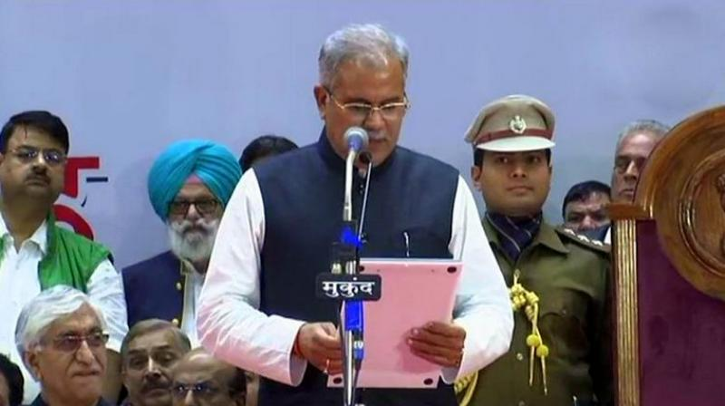 Bhupesh Baghel administered oath of office by Governor Anandiben Patel at the ceremony held at an indoor stadium in Raipur. (Photo: ANI)