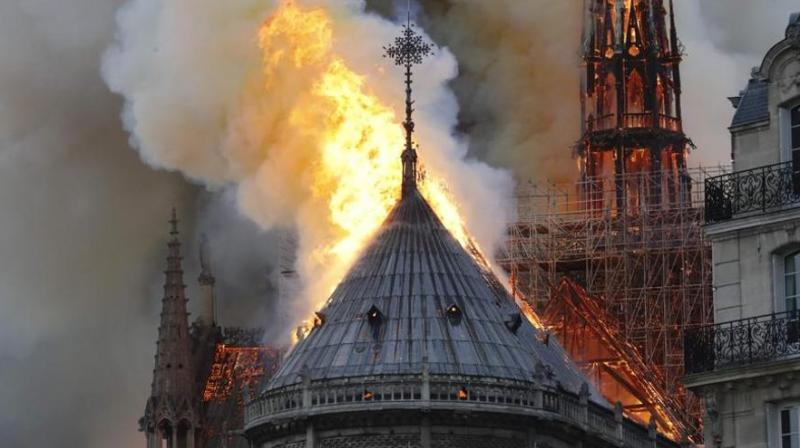 The inferno destroyed the roof of the 850-year-old UNESCO world heritage landmark, whose spectacular Gothic spire collapsed as orange flames and clouds of grey smoke billowed into the sky. (Photo: AP)