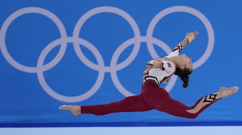 Pauline Schaefer-Betz, of Germany, performs her floor exercise routine during the women's artistic gymnastic qualifications at the 2020 Summer Olympics, Sunday, July 25, 2021, in Tokyo. (AP)