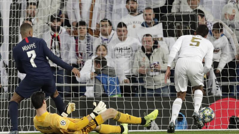 Karim Benzema knocked into an empty net to give Real the lead in the 17th minute of his 100th Champions League start and the French forward doubled the advantage with a 79th minute header.  Yet Kylian Mbappe immediately reduced the deficit in the 81st minute, capitalising on a mistake from Real goalkeeper Thibaut Courtois before Pablo Sarabia equalised in the 82nd. (Photo:AP)