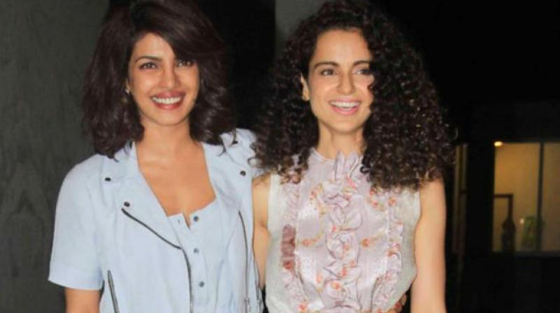 Priyanka Chopra and Kangana Ranaut celebrating together.