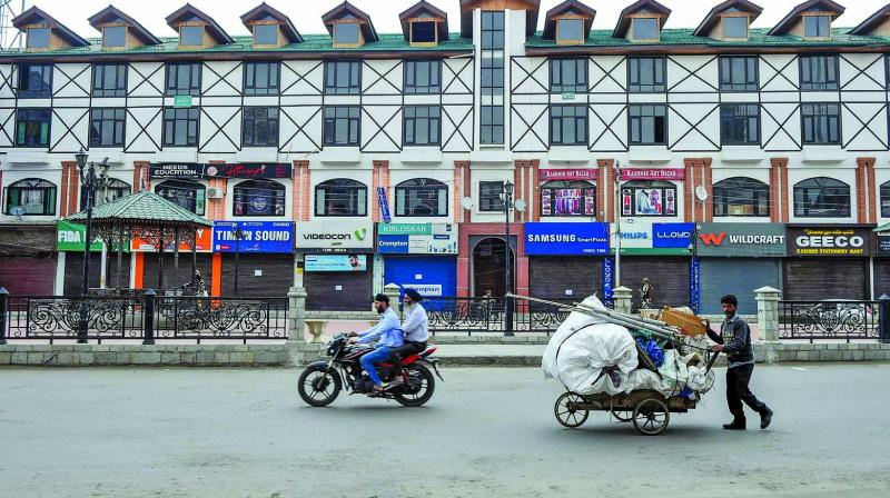 A view of A deserted Lal Chowk area in Srinagar Wednesday. (Photo: PTI)