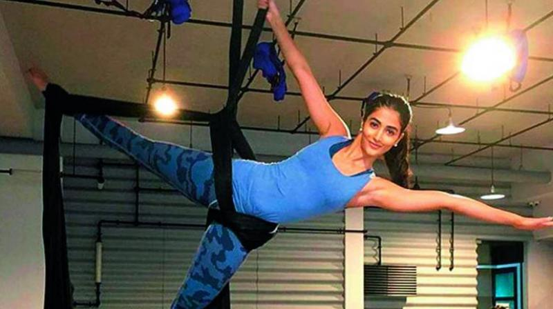Pooja Hegde incorporates circuit and interval training in addition to calisthenics, Pilates, aerial silk moves and kickboxing in her fitness regimen.