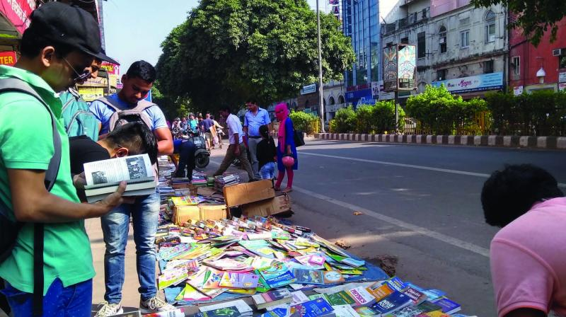 Enthusiastic book lovers bargaining at the erstwhile Sunday book market in Daryaganj.